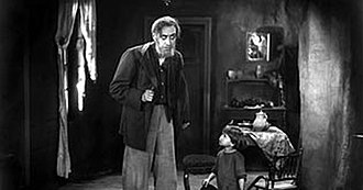 The Street (1923 film) - Max Schreck as the blind man. The little boy helps him get dressed to go out.
