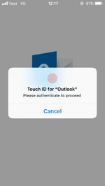 Screenshot of the loading screen of Microsoft Oulook on iOS 11, with the prompt for Touch ID unlock displayed