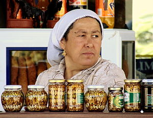 A woman selling nuts at a roadside in Izmir Province, Turkey.