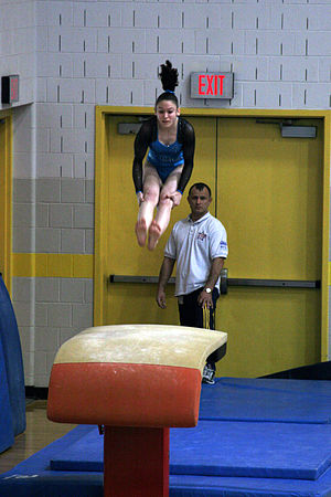 Gymnastics - Piked Tsukahara vault.