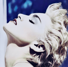 Madonna in white blond, short hair tilts her head back, with the album name appearing atop her image.