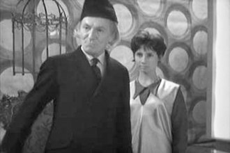 An Unearthly Child - William Hartnell and Carole Ann Ford in the original pilot episode. Note the change in costumes compared to the screen capture of the same scene, above.