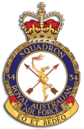 "Crest of 34 Squadron, Royal Australian Air Force, featuring winged messenger in gold, two crossed arrows, and the motto ""Eo et redeo"""