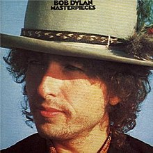 A close-up of Dylan's face turned sideways and wearing a hat