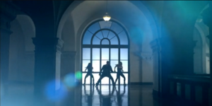 DJ Got Us Fallin' in Love - Usher and two female dancers performing choreography to the song's second verse, with a large window as a backdrop.