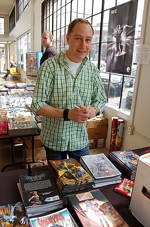 Darren G. Davis - Davis signing his work from Bluewater Productions during Free Comic Book Day in Bellingham, Washington.