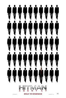 Ten rows of 5 indistinct figures. The 47th figure is bald, wearing a suit with a white shirt and red tie.