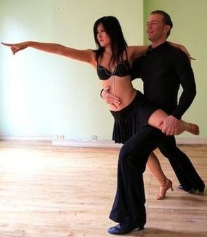 Impossible Is Nothing (video résumé) - Frame from title video illustrating ballroom dancing scene.