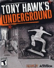 "A man sprints out of sight down an urban alley. A brick building he runs past, which is in the foreground, features a lightened outline of a skateboarder. The text ""Tony Hawk's Underground"" appears in all-caps at the top of the image; it resembles a stencil used for graffiti."