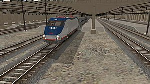 Trainz - Screenshot of TS12 or Trainz Simulator 12 in driver mode showing an Amtrak HHP-8 at 30th Street Station