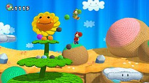 Yoshi's Woolly World - E3 2014 screenshot of Yoshi's Woolly World. The characters and environment are depicted as living yarn knits, a theme that continues throughout the game.