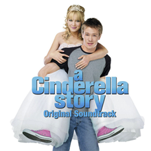 "A young blonde girl carried on the back of a young brown-haired man. The girl is wearing a white tiara, white ball gown, and pink tennis shoes; the boy wears a gray shirt with black sleeves, and blue jeans. On their image, the words ""A Cinderella Story"" and ""Original Soundtrack"" are written in blue, bold font."