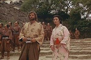 John Blackthorne - Richard Chamberlain as John Blackthorne with Yoko Shimada as Mariko (Lady Toda Buntaro) in the Shōgun television miniseries.