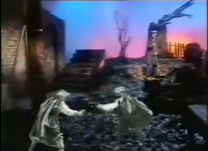 Elstree (song) - Trevor Horn (top right) as he appears in the video as a BBC janitor on a cemetery set, while black-and-white characters (bottom) play as various roles he recalls in the song.