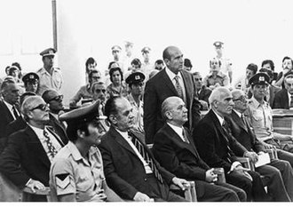 Greek Junta Trials - The junta on trial. Ioannidis standing up while Papadopoulos, Makarezos and Pattakos watch the proceedings from the front row