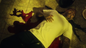 Paranoid (Ty Dolla Sign song) - A screenshot of the music video, where Ty Dolla Sign is laying on the floor after being stabbed.