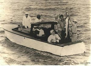 Farley Boats - President Roosevelt catching a tarpon on a Farley Boat. Barney Farley is holding the tarpon.