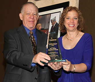 Debbie Wasserman Schultz - Debbie Wasserman Schultz receives award from Plantation Democratic Club President Marvin Quittner, May 5, 2013.