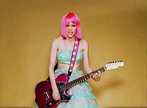 The Best Damn Thing (song) - Lavigne plays guitar in the video.