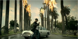 Burn (Usher song) - Usher dancing in front of an Aston Martin DB5, while the scenery is set aflame
