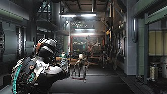 Dead Space 2 - Isaac Clarke (left), wearing the game's Advanced RIG suit, fights off a swarm of Necromorphs.