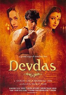 The theatrical poster of Devdas, featuring the leading cast (Shah Rukh Khan, Aishwarya Rai Bachchan and Madhuri Dixit). Khan features on the middle, holding a bottle of alcohol, while Rai Bachchan and Dixit on the right and left of him, respectively.