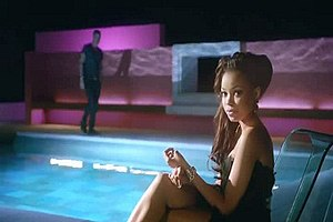 "Foolin' (Dionne Bromfield song) - Dionne Bromfield in the scene where she is sitting by a swimming pool in the music video for ""Foolin""."