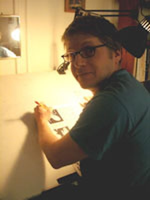 Josh Neufeld - Neufeld at his drawing table, c. 2005.