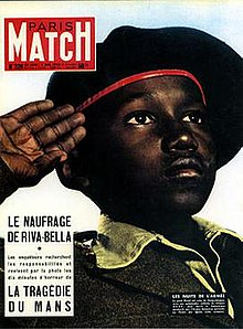 Image result for Parisian magazine, where a young negro in French uniform salutes with his eyes