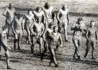 Unrecognizable after playing on a muddy SCG, footballers of the British and Australian national rugby league sides leave the field after the first Test on 12 June 1950. SCG rugby league match 1950.JPG