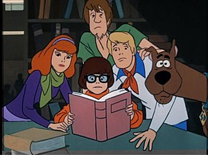 "Scooby-Doo - A scene from ""What a Night for a Knight"", the first episode of Scooby-Doo, Where Are You!—clockwise from top: Shaggy, Fred, Scooby, Velma, and Daphne."