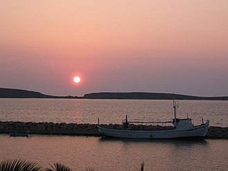 Sigri (village) - Sigri's harbour and the island of Nissiopi at sunset.