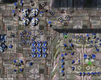 Total Annihilation - An in-game screenshot of a Core base. Near the bottom-right corner the Commander (with the yellow backpack) is visible assisting a factory in construction.