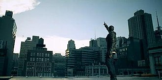 Written in the Stars (Tinie Tempah song) - Tinie Tempah pointing up into the sky in the video.