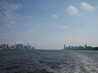 Downtown Jersey City - Lower Manhattan (left) and Jersey City (right) skylines, viewed from the Hudson River