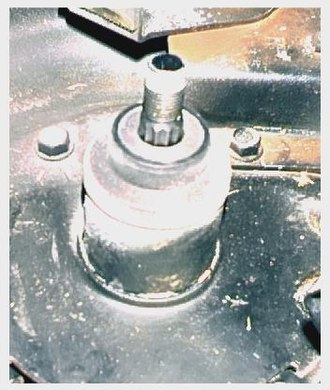 Mandrel - Pulley-driven mandrel used to hold lawn tractor cutting blades