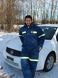 Dr. Mohamed H. Elsanabary is photographed standing in front of a NISSAN car at the Paddle River basin, Alberta, January 12, 2008.
