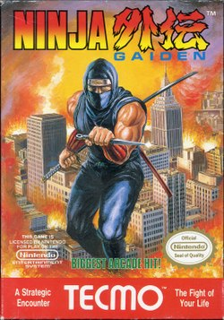 "The logo of Ninja Gaiden is on the top of the screen. In the middle of the image is a depiction of a ninja in blue with a knife in his left hand and a bo and katana stored on his back. The ninja is portrayed in a background of a burning city. Below the ninja is green text saying in caps ""BIGGEST ARCADE HIT!"", and to the left and right of that text are Nintendo's license notice and Seal of Quality respectively. In the bottom of the image, in red with white lettering, is the TE©MO logo, with text to the left of the logo saying ""A Strategic Encounter"" and with text to the right of the logo saying ""The Fight of Your Life""."