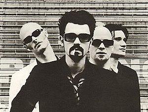 Shudder to Think - Shudder to Think, 1996. L-R: Craig Wedren, Nathan Larson, Kevin March, and Stuart Hill.