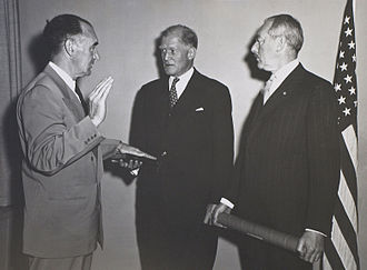 Stanley Andrews (journalist) - Swearing in of Stanley Andrews as Administrator, Technical Cooperation Administration, by State Department Chief of Protocol John F. Simmons, as Secretary of State Dean Acheson observes, April 24, 1952. U.S. Department of State photo, Truman Presidential Library, catalog number 72-116