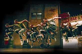 The Car Man (Bourne) - The company of Matthew Bourne's The Car Man, with danseur Alan Vincent in the lead role of Luca.