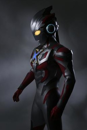 """Ultraman X - Ultraman X, the series' titular hero, sporting a pair of headphone-shaped ears and an """"X"""" shaped Color Timer."""