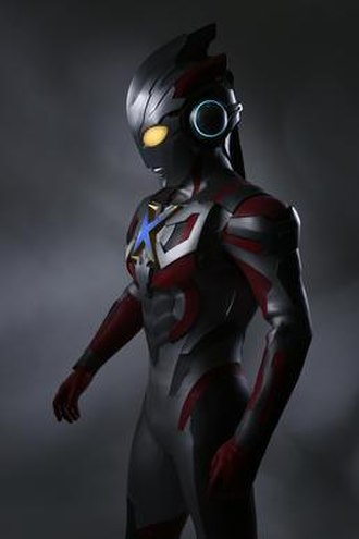 "Ultraman X - Ultraman X, the series' titular hero, sporting a pair of headphone-shaped ears and an ""X"" shaped Color Timer."