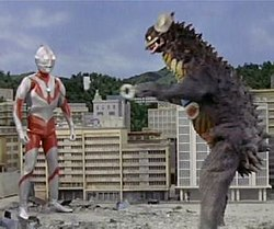 A screenshot of Ultraman fighting the monster Gyango