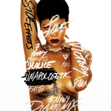 "A picture of a woman with short black hair and dark lipstick, standing in front of a white back ground her nude torso is covered in graffiti-style words such as ""Side Effects"" in black font on her arm, the rest of words are in white/grey font ""Victory"", ""Chalice"", ""Diamonds"", ""#Navy"", ""7"", ""#R7"", ""Happy"", ""Censored"", ""Love"", ""Roc"", ""Fun"", and ""Fearless"" as well as ""Unapologetic"" covering her left side nipple, she also has very thin jewelry, a pair of small earrings and two thin chains one around her neck, the other around her nude torso, also showing her tattoo of the Egyptian goddess Isis between her cleavage.[1]"