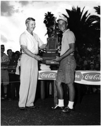 International Jaycee Junior Golf Tournament - Jerry Greenbaum is presented with the championship trophy after winning the 13th International Jaycee Junior Golf Tournament in 1958.