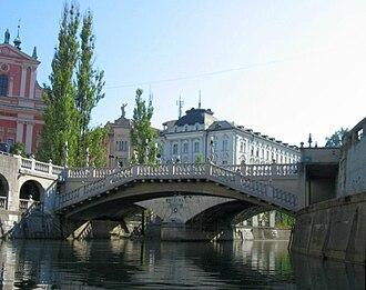Triple Bridge - Downstream view of the Triple Bridge from the Ljubljanica River