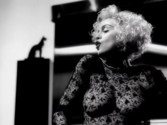 "Vogue (Madonna song) - Madonna wearing the controversial sheer lace blouse in the black and white ""Vogue"" music video."