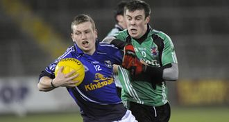 County Cavan - Cavan (blue) in action against The Queen's University of Belfast in the 2009 Dr. McKenna Cup