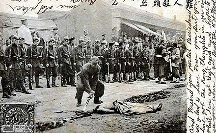 German and Japanese soldiers witnessing the street execution of a Chinese boxer. EightNationsCrime01.jpg